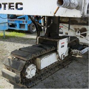 close-up track pads red excavator riotrack 06